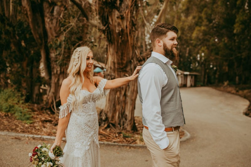 Elopement photographer, Carmel by the sea, California, bride tapping groom on shoulder for first look