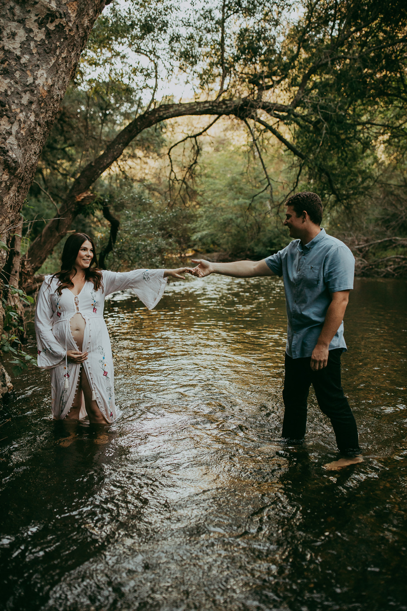 Maternity Photography, couple holding hands in creek