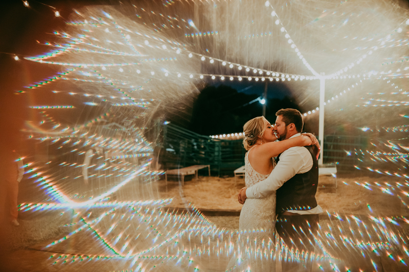 Elopement Photography, couple dancing on lit up dance floor