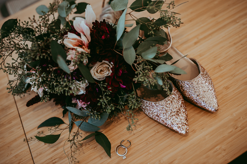 Elopement Photography, bridal bouquet, shoes, and ring set flat lay