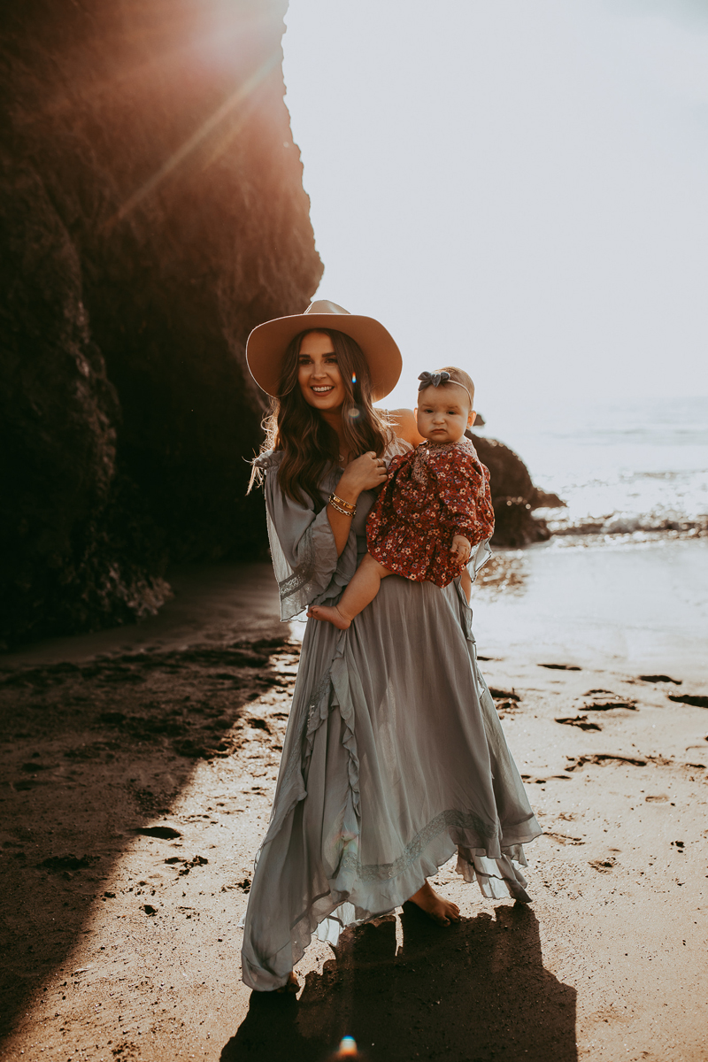 Family Photography, mother and baby daughter standing at the beach