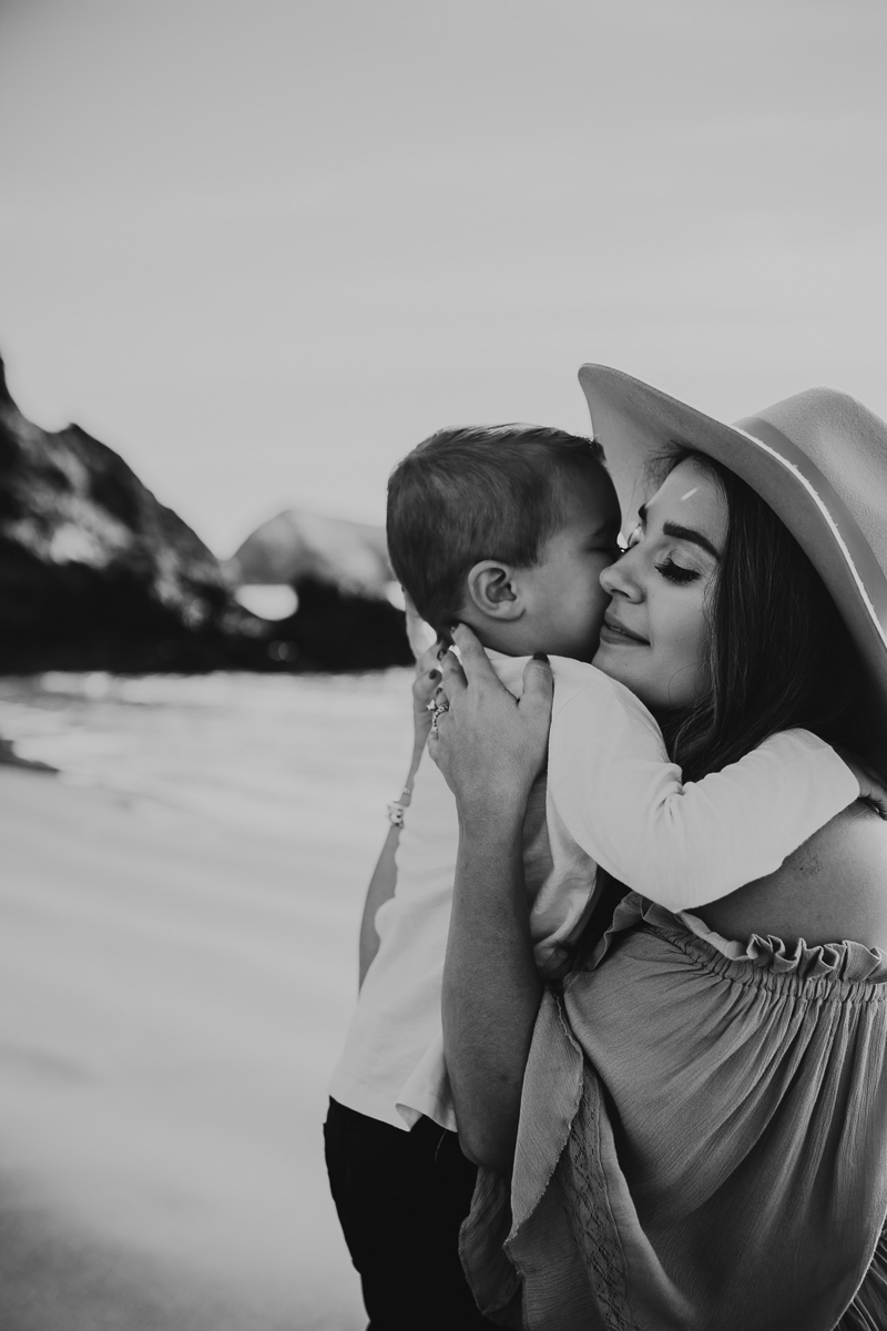 Family Photography, mother picking up and hugging little boy