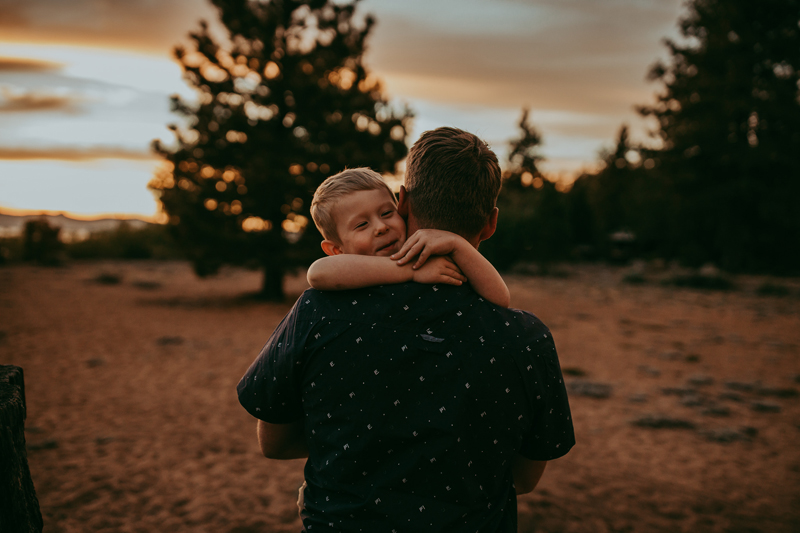 Family Photography, father holding up son for a hug
