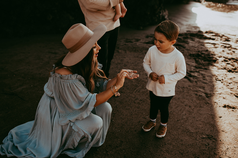 Family Photography, mother showing son a sea shell
