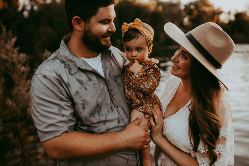 Family Photography, couple posing with little baby girl in dad's arms