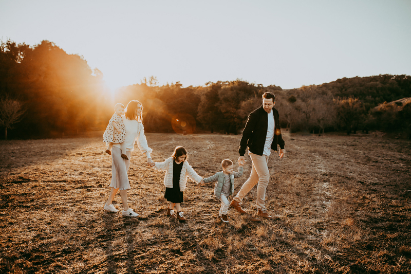 Family Photography, family of 5 walking together in a field
