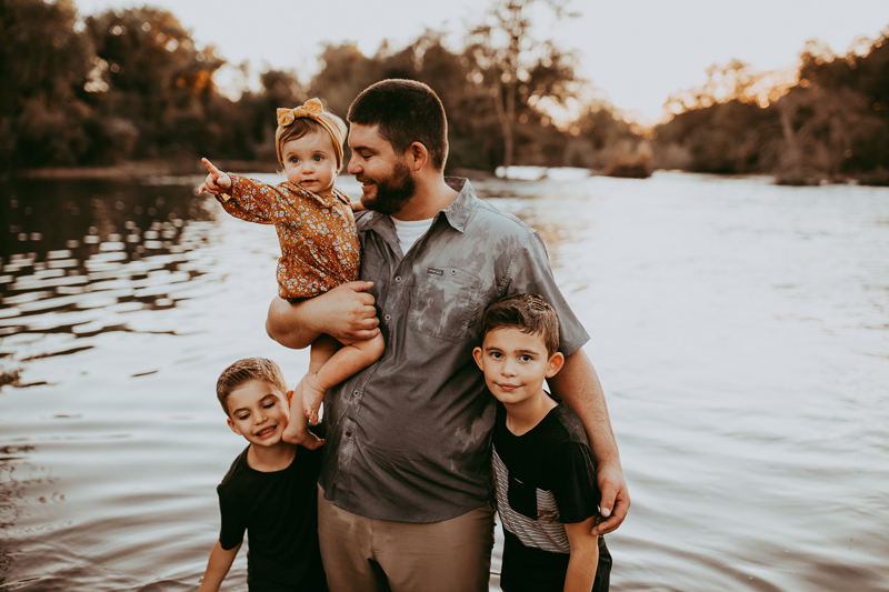 Family Photography, father standing in lake with three kids