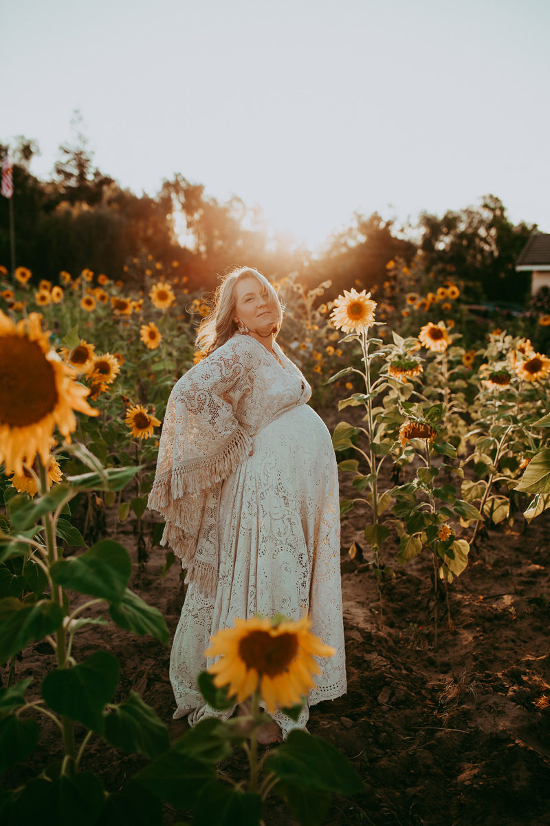 Maternity Photography, pregnant woman in the middle of a bunch of sunflowers