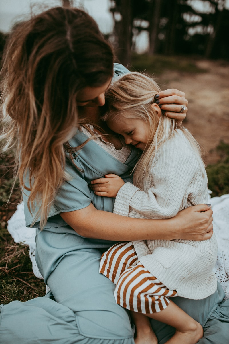 Maternity Photography, daughter cuddled into her mother