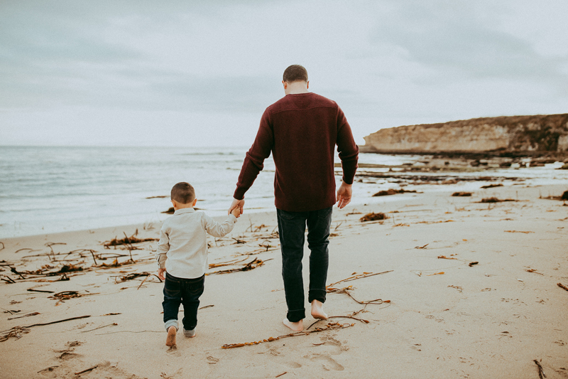 Family Photography, father and son walking on the beach together