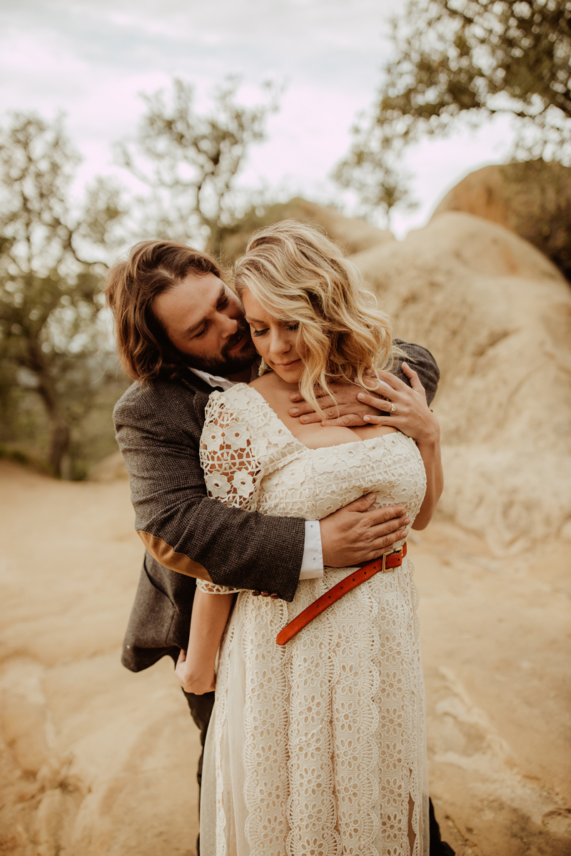 Elopement Photography, grooms holding bride by her chest