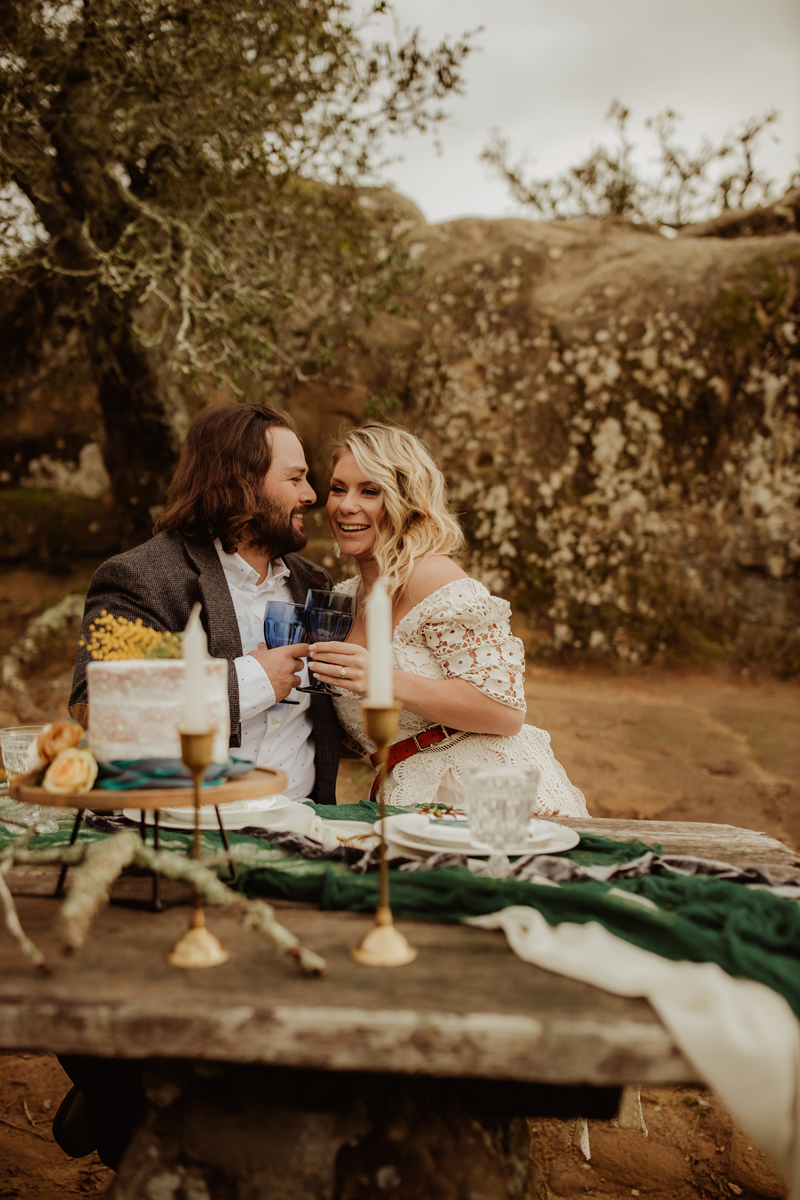 Elopement Photography, bride and groom smiling and laughing together at table