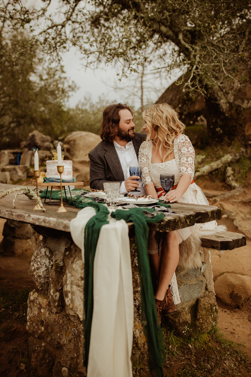 Elopement Photography, bride and groom sitting at a table together