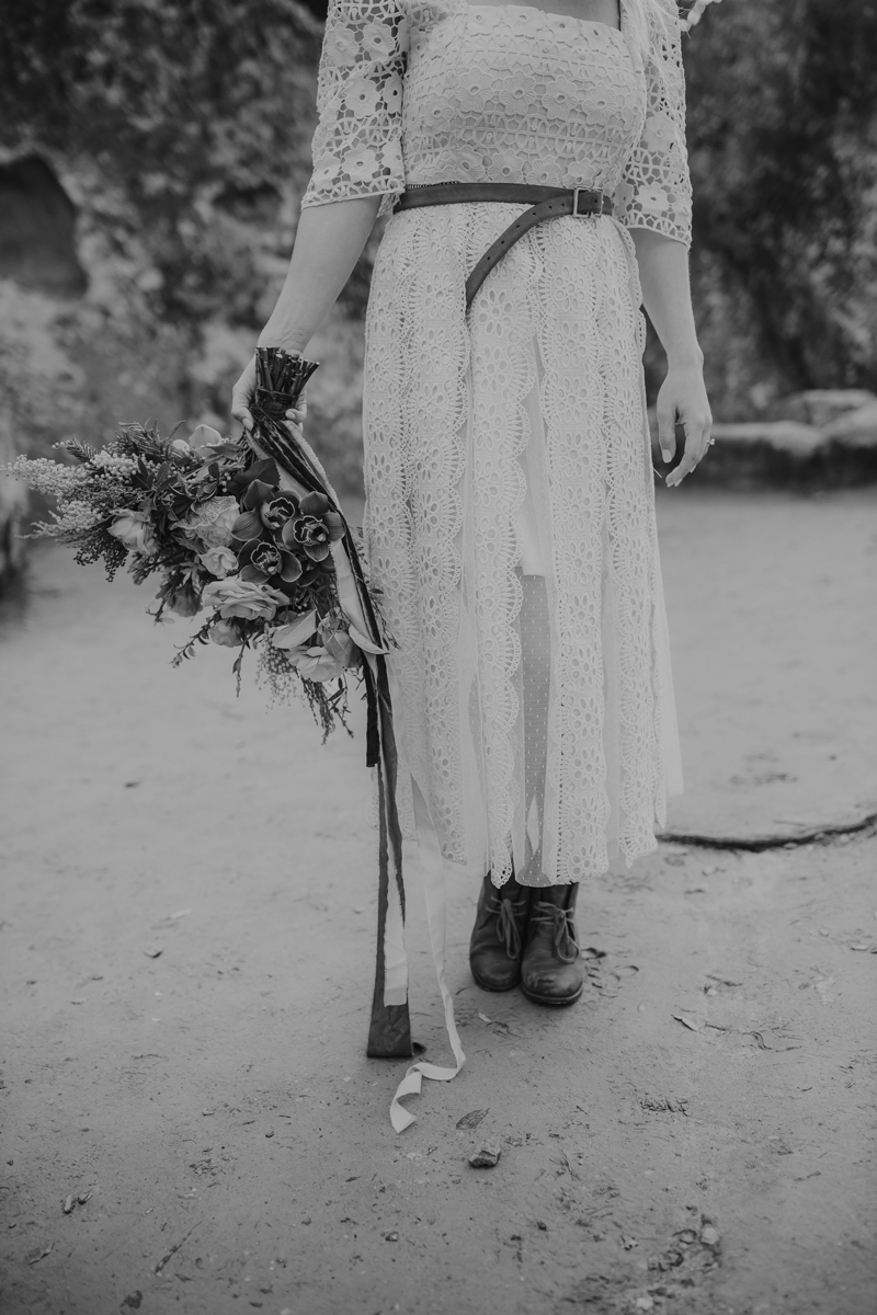 Elopement Photography, black and white image of bride with bouquet