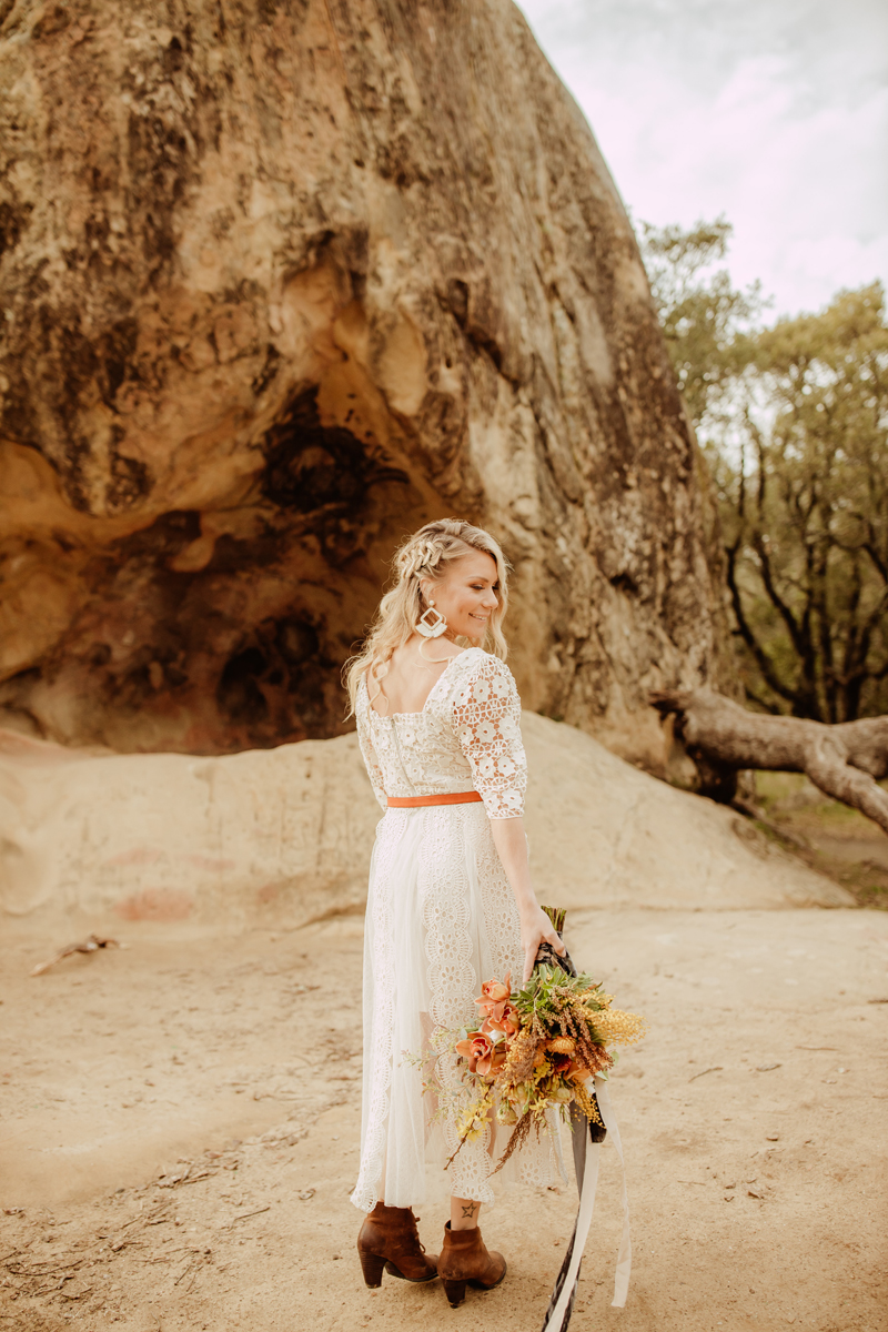 Elopement Photography, bride walking away from camera and looking over her shoulder