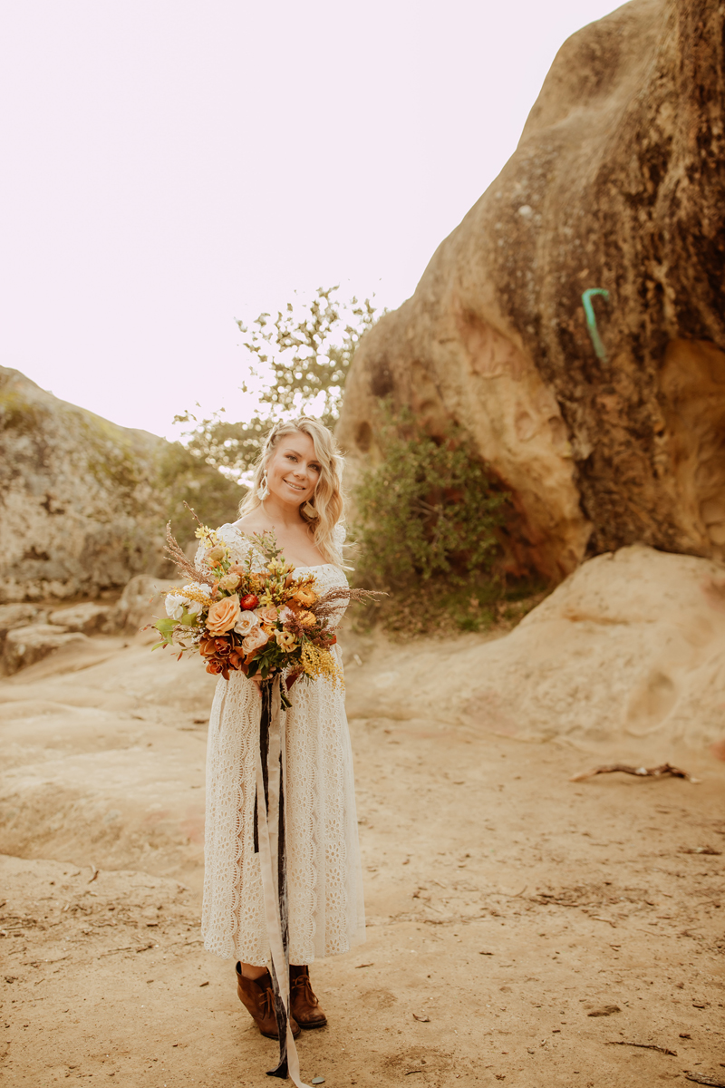 Elopement Photography, bride standing with her bouquet