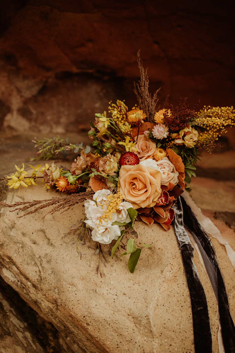 Elopement Photography, wedding bouquet sitting on rock