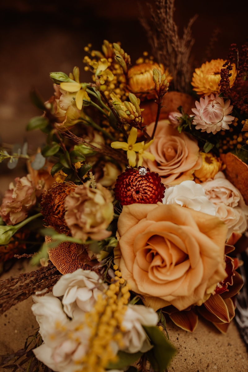 Elopement Photography, ring sitting on wedding bouquet