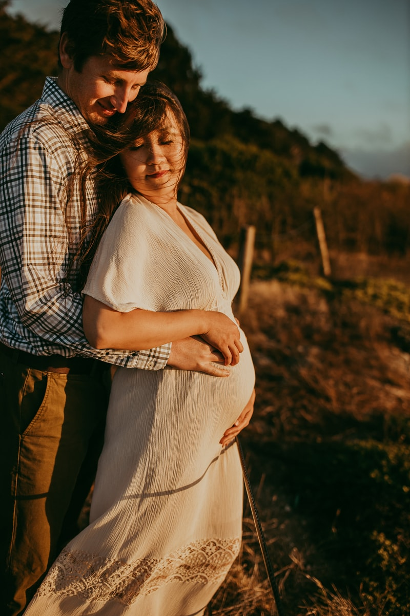 Maternity Photography, couple standing together at sunset