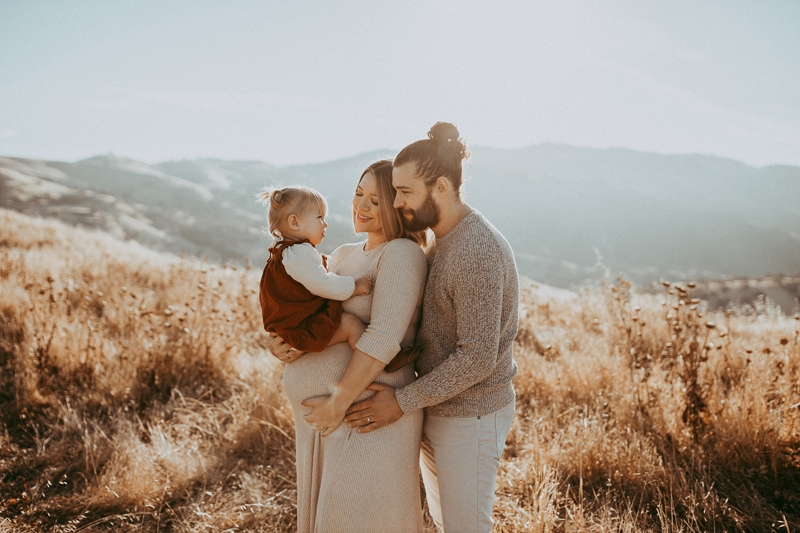 Maternity Photography, family of three in grassy field