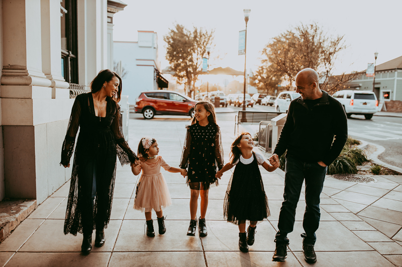 Family Photography, family of five walking along a city sidewalk