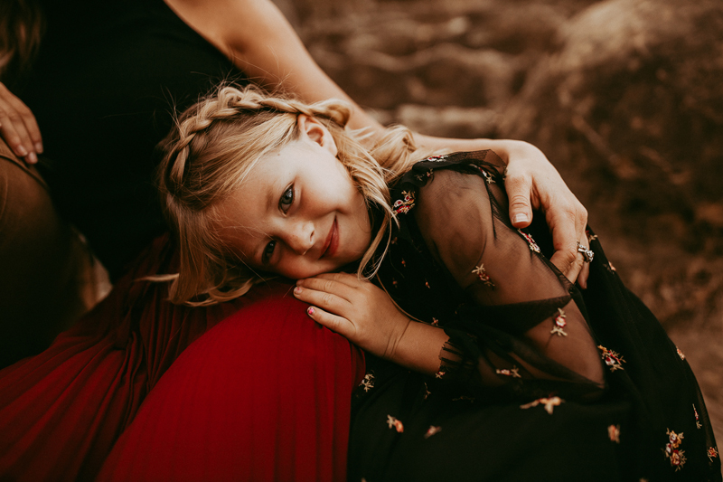 Family Photography, little girl resting her head on her mom