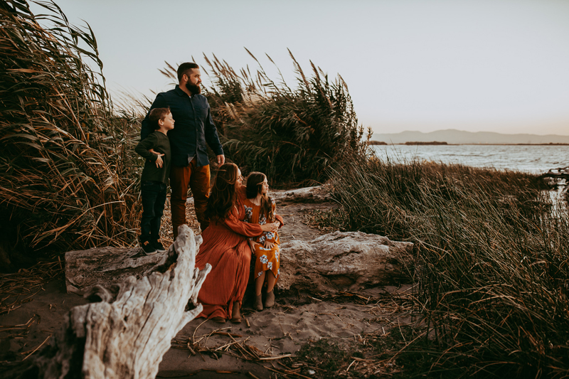 Family Photography, family of 4 looking out over the bay