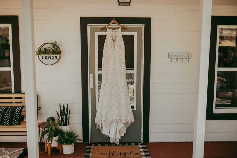 Elopement Photography, bridal gown hanging on house door