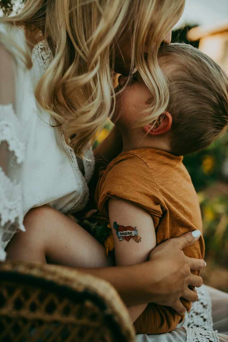 Motherhood Photography, mother kissing son's forehead