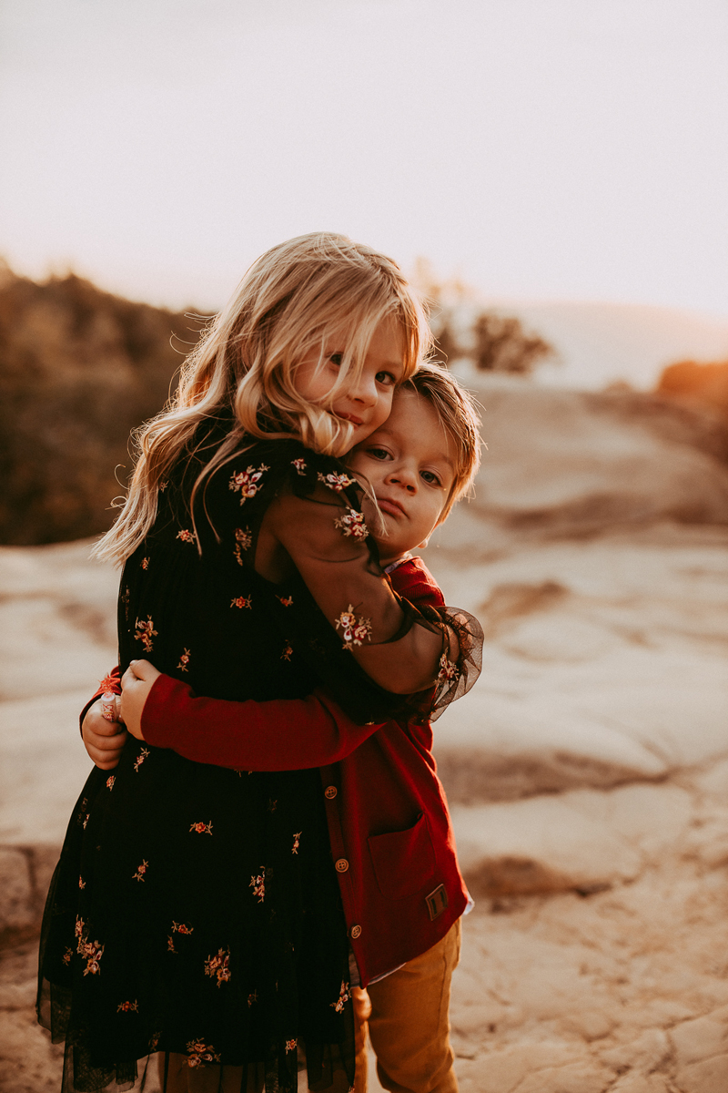 Family Photography, brother and sister hugging each other