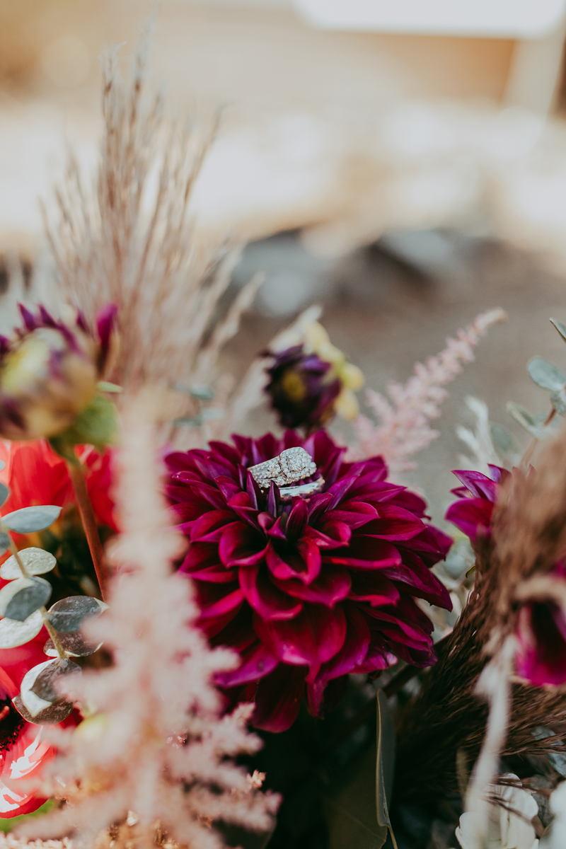 Elopement Photography, detail shot of ring sitting on bouquet