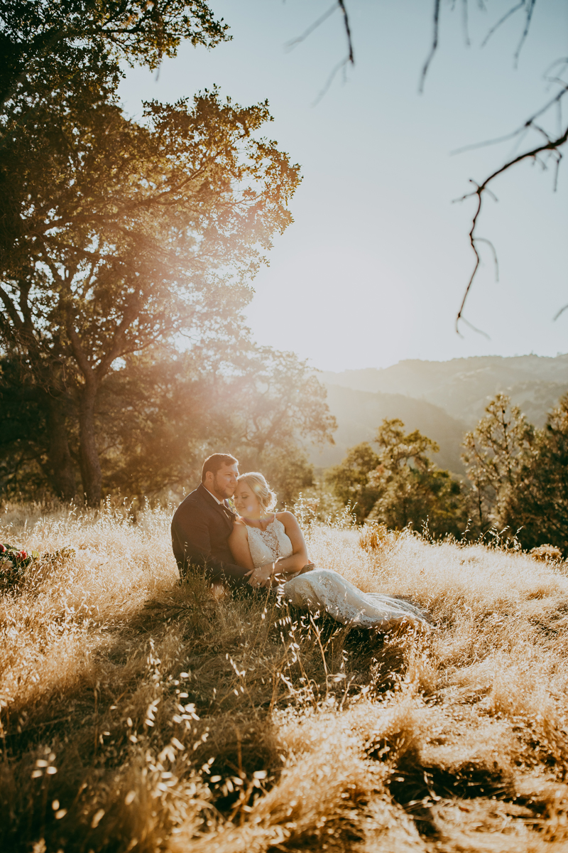 Elopement Photography, couple sitting in grass