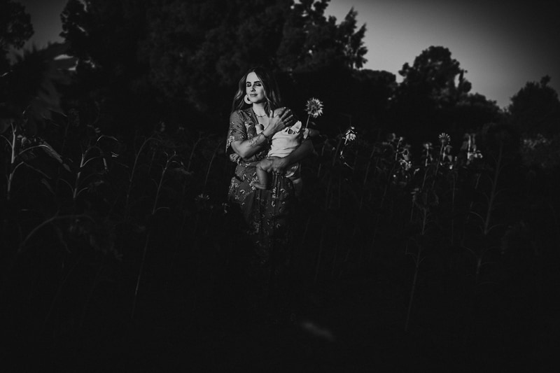 Motherhood Photography, black and white of mother holding baby in a field