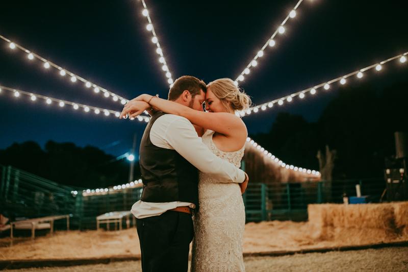 Elopement Photography, couple dancing under bulb lights