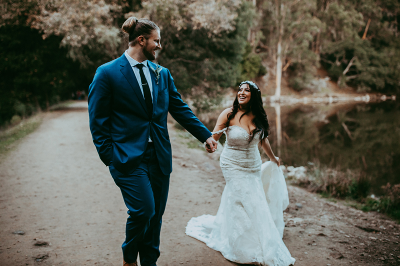 Elopement Photography, bride and groom walking down a dirt path