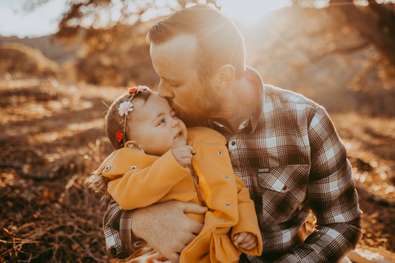 Family Photography, father kissing baby girl on the forehead