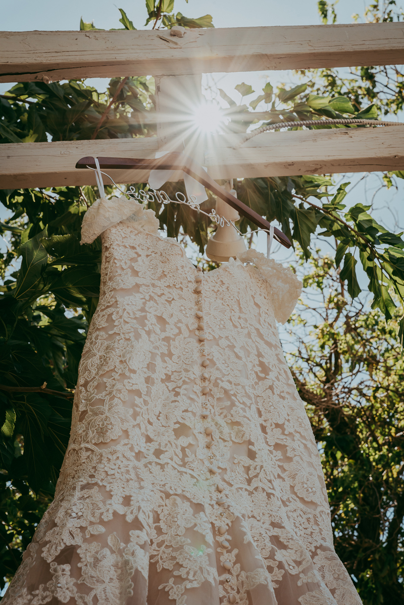 Elopement Photography, dress hanging up on wooden beam