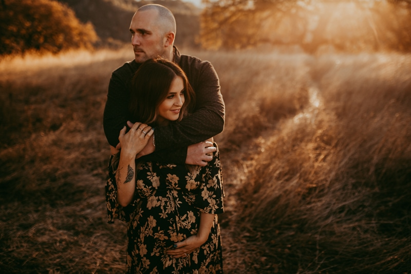 Maternity Photography, man with his arms around woman