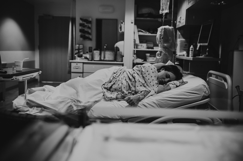 Birth Photography, mother laying on her side during labor