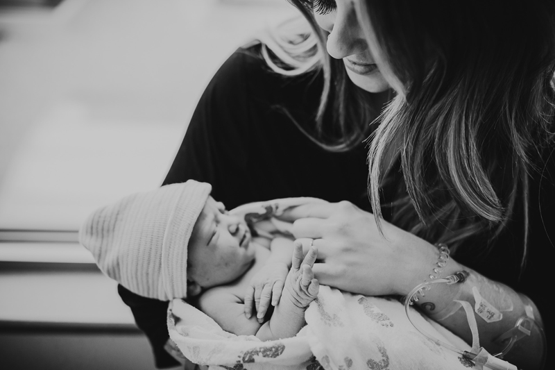Birth Photography, Black and white of mother with new baby in her arms